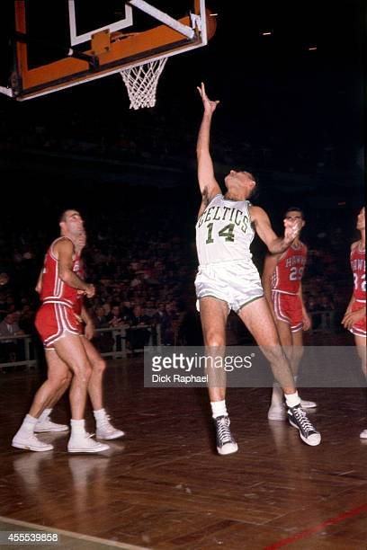 Bob Cousy of the Boston Celtics drives to the basket against the Atlanta Hawks during a game circa 1960 at the Boston Garden in Boston Massachusetts...
