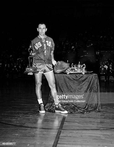 Bob Cousy of the Boston Celtics is presented a sports achievement award for his outstanding performance as a player and inspiration to the Youth of...
