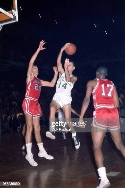 Bob Cousy of the Boston Celtics passes the ball against the St Louis Hawks circa 1960 at the Boston Garden in Boston Massachusetts NOTE TO USER User...