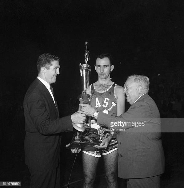 """Bob Cousy of the Boston Celtics, receives """"Most Valuable Player"""" award from Murray Olderman of NEA, and Maurice Podoloff President of the NBA...."""