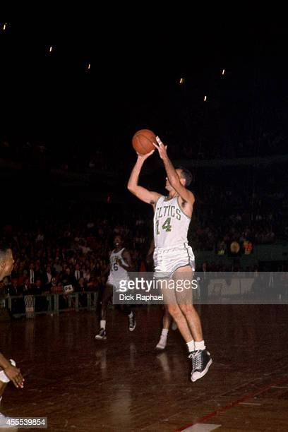 Bob Cousy of the Boston Celtics shoots the ball during a game circa 1962 at the Boston Garden in Boston Massachusetts NOTE TO USER User expressly...