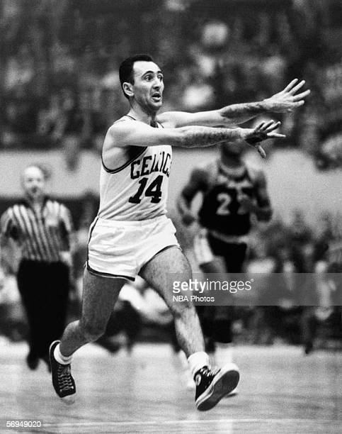 Bob Cousy of the Boston Celtics throws a pass at the Boston Garden circa 1960 in Boston Massachusetts NOTE TO USER User expressly acknowledges that...