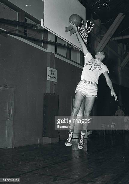 Bob Cousy sixfoot two inch forward on the Holy Cross basketball team and rated the country's most outstanding cageman shown in these action pictures...