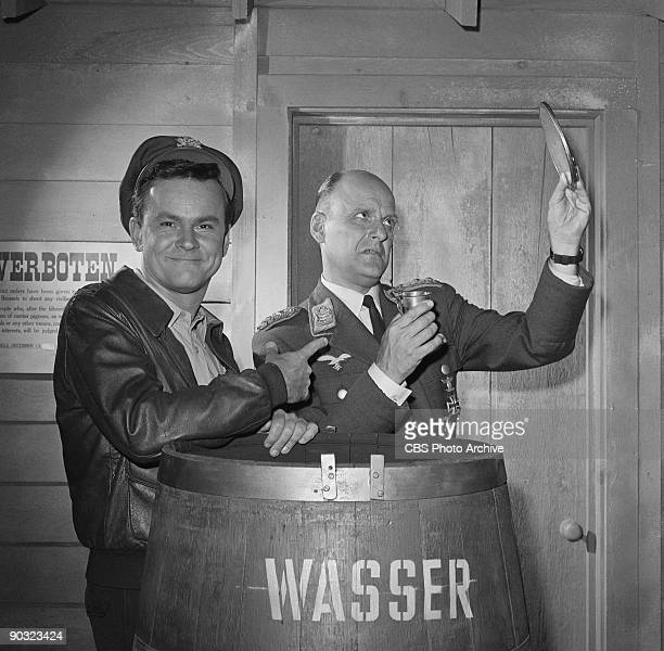 HEROES Bob Crane as Col Robert E Hogan left Werner Klemperer as Col Wilhelm Klink in Go Light On the Heavy Water an episode from the CBS television...
