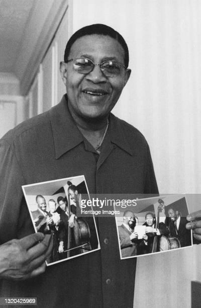 Bob Cranshaw, Swinging Jazz Party, Blackpool backstage holding photos of the Junior Mance Trio taken by Brian Foskett. Artist Brian Foskett.