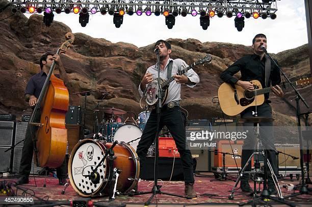 Bob Crawford Scott Avett and Seth Avett performing with the 'Avett Brothers' at Red Rocks Amplitheater in Morrison Colorado on September 2 2010