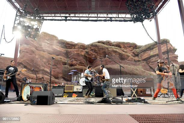 Bob Crawford Scott Avett Seth Avett and Joe Kwon of The Avett Brothers perform at Red Rocks Amphitheatre on July 1 2018 in Morrison Colorado