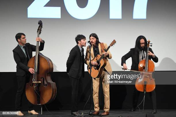 Bob Crawford Scott Avett Seth Avett and Joe Kwon of The Avett Brothers perform during the 'May It Last A Portrait Of The Avett Brothers'premiere 2017...