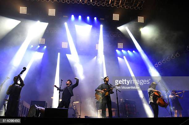 Bob Crawford Scott Avett Seth Avett Joe Kwon and Tania Elizabeth of The Avett Brothers perform during the Okeechobee Music Arts Festival on March 6...