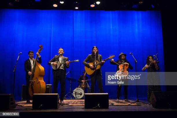 Bob Crawford Scott Avett Seth Avett Joe Kwon Tania Elizabeth and Mike Marsh of The Avett Brothers perform during HBO's 'May It Last A Portrait of the...