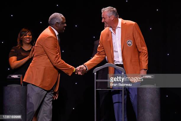 Bob Dandridge and Toni Kukoc shake hands during the Class of 2021 Tip-Off Celebration and Awards Gala as part of the 2021 Basketball Hall of Fame...