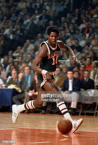 Bob Dandridge of Milwaukee Bucks goes in for a layup against the Baltimore Bullets during an NBA basketball game circa 1972 at the Baltimore Civic...