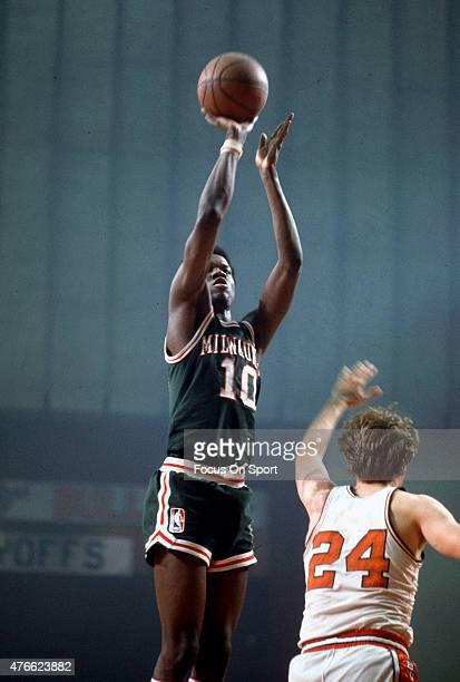 Bob Dandridge of Milwaukee Bucks goes up to shoot over Jack Marin of the Baltimore Bullets during an NBA basketball game circa 1972 at the Baltimore...