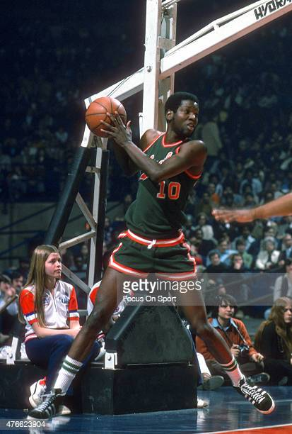 Bob Dandridge of Milwaukee Bucks looks to pass the ball in-bounds against the Baltimore Bullets during an NBA basketball game circa 1975 at the...