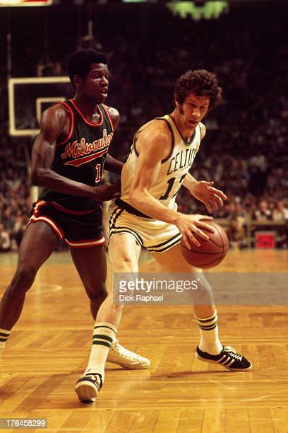 Bob Dandridge of the Milwaukee Bucks defends John Havlicek of the Boston Celtics during a game played circa 1974 at the Boston Garden in Boston...
