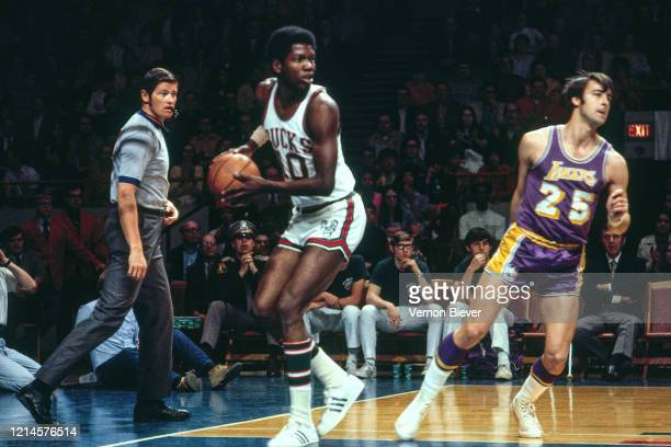 Bob Dandridge of the Milwaukee Bucks handles the ball against the Los Angeles Lakers during a game circa 1970 at the MECCA Arena in Milwaukee,...