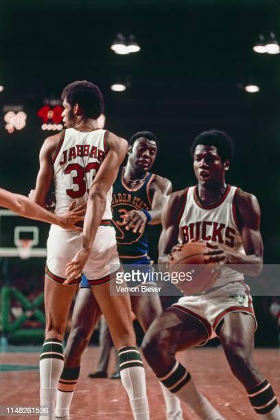 Bob Dandridge of the Milwaukee Bucks handles the ball against the Golden State Warriors on March 7, 1974 at the Milwaukee Arena in Milwaukee,...