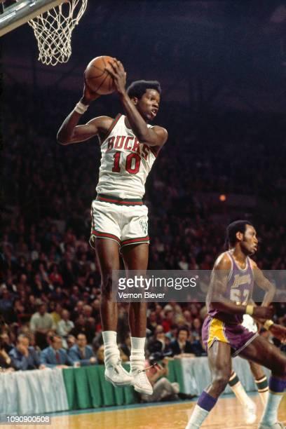 Bob Dandridge of the Milwaukee Bucks rebounds the ball against the Los Angeles Lakers on December 21, 1970 at the Milwaukee Arena in Milwaukee,...