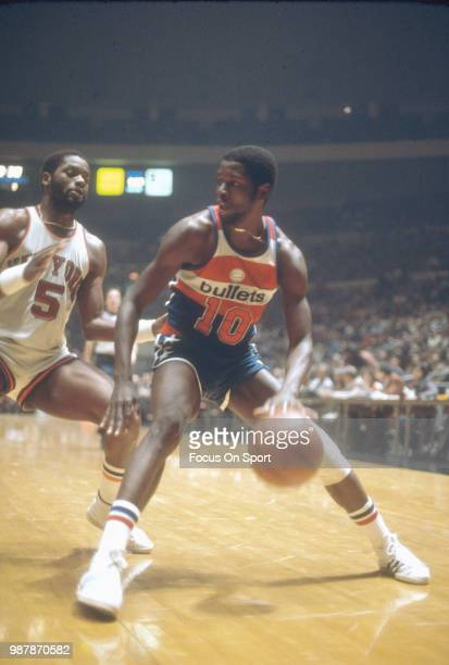 Bob Dandridge of the Washington Bullets drives on Jim McMillian of the New York Knicks during an NBA basketball game circa 1977 at Madison Square...