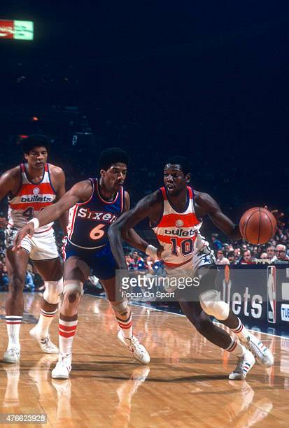 Bob Dandridge of the Washington Bullets drives on Julius Erving of the Philadelphia 76ers during an NBA basketball game circa 1977 at the Capital...