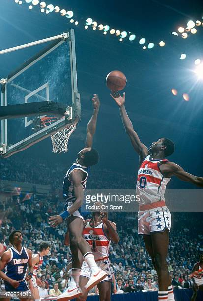 Bob Dandridge of the Washington Bullets goes up for a rebound over David Thompson of the Denver Nuggets during an NBA basketball game circa 1979 at...