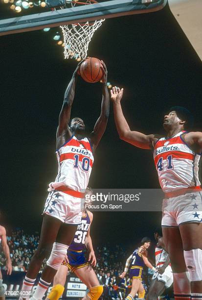 Bob Dandridge of the Washington Bullets goes up to grab a rebound against the New Orleans Jazz during an NBA basketball game circa 1979 at the...