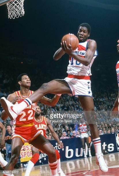 Bob Dandridge of the Washington Bullets grabs a rebound over John Drew of the Atlanta Hawks during an NBA basketball game circa 1978 at the Capital...