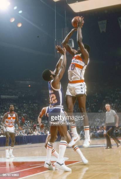 Bob Dandridge of the Washington Bullets shoots over Bob Wilkerson of the Denver Nuggets during an NBA basketball game circa 1978 at the Capital...