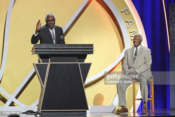 Bob Dandridge speaks to the crowd with Oscar Robertson on stage during the 2021 Basketball Hall of Fame Enshrinement Ceremony on September 11, 2021...
