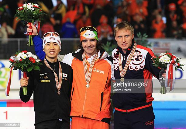 Bob de Jong of Netherland for first place and Seung-Hoon Lee of Korea for second place and Ivan Skobrev of Russia for third place, take place on the...