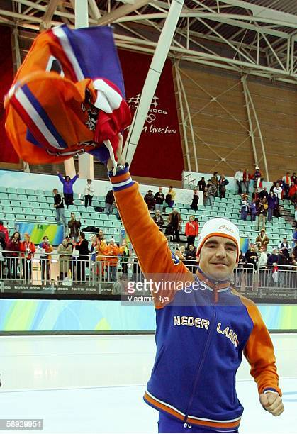 Bob de Jong of the Netherlands celebrates winning the Gold medal with a time of 130157 in the 10000 meter men's speed skating final during Day 14 of...