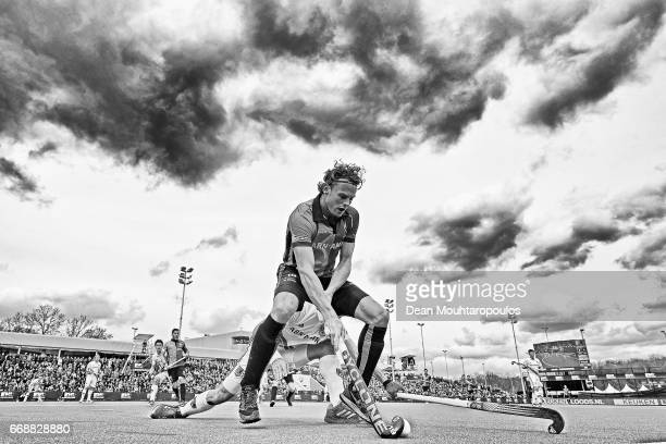 Bob De Voogd of HC OranjeRood battles for the ball with Justin ReidRoss of AH BC Amsterdam during the Euro Hockey League KO16 match between HC...