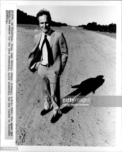 Bob Debus, the member for the Blue Mountains, waits whistfuly for his leader at Katoomba airstrip.***** is a member of the first twenty in the Wran...