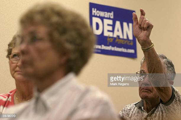 Bob DeGroote, of Corwith, Iowa, waits to ask Democratic presidential candidate hopeful Howard Dean a question after he spoke at the Pizza Ranch...