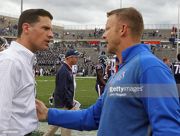 Bob Diaco of the Connecticut Huskies shakes hands with Bryan Harsin of the Boise State Broncos after a Bronco 3821 win at Rentschler Field on...
