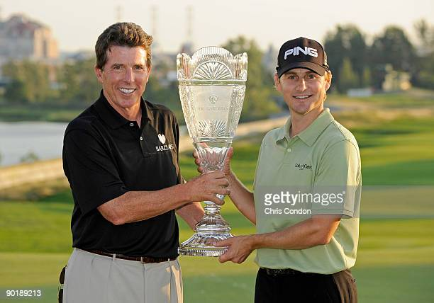 Bob Diamond of Barclays Capital and Heath Slocum pose with the tournament trophy after winning the The Barclays at Liberty National Golf Club on...