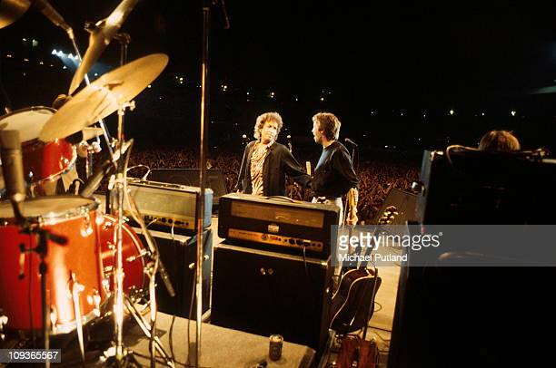 Bob Dylan and Eric Clapton perform on stage Wembley London 7th July 1984