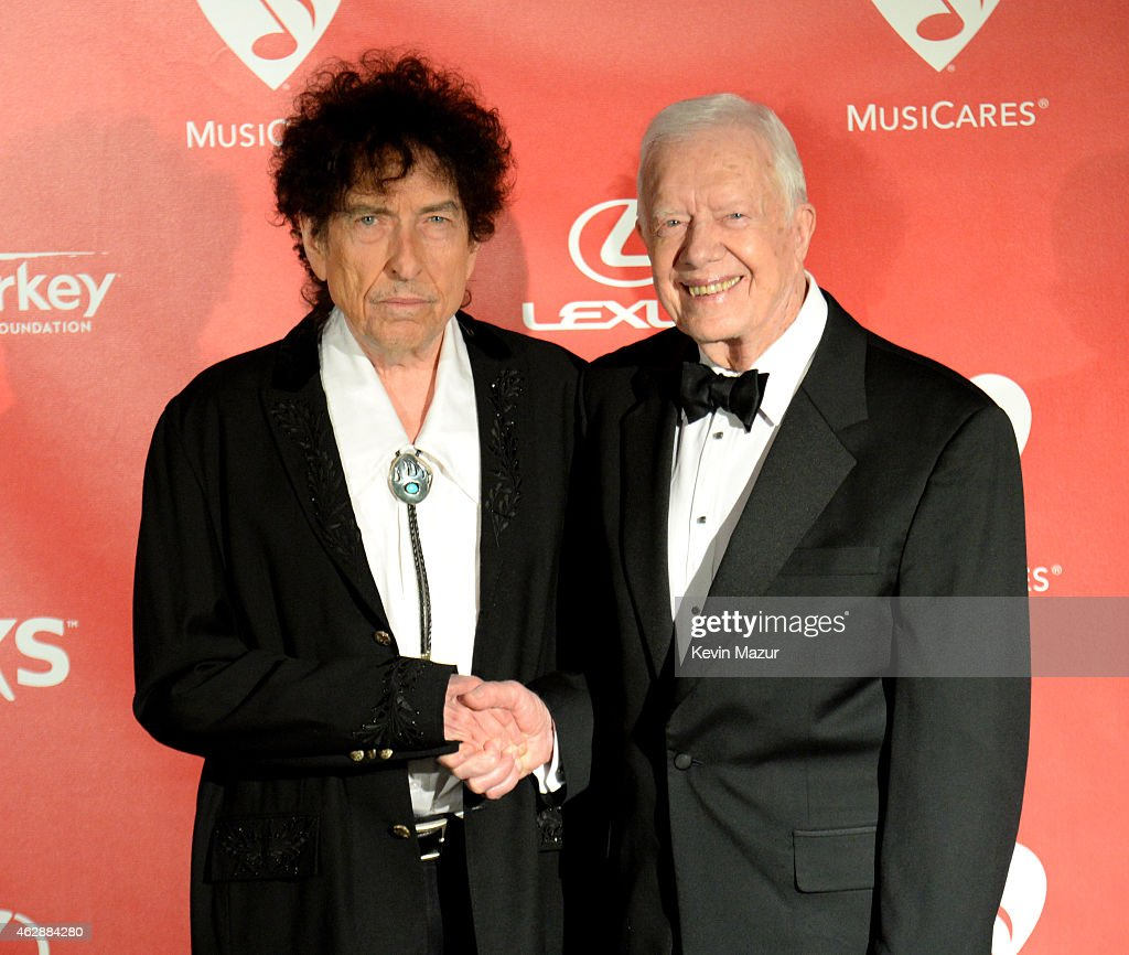Bob Dylan and former United States President Jimmy Carter attend the 25th anniversary MusiCares 2015 Person Of The Year Gala honoring Bob Dylan at the Los Angeles Convention Center on February 6, 2015 in Los Angeles, California. The annual benefit raises critical funds for MusiCares' Emergency Financial Assistance and Addiction Recovery programs. For more information visit musicares.org.