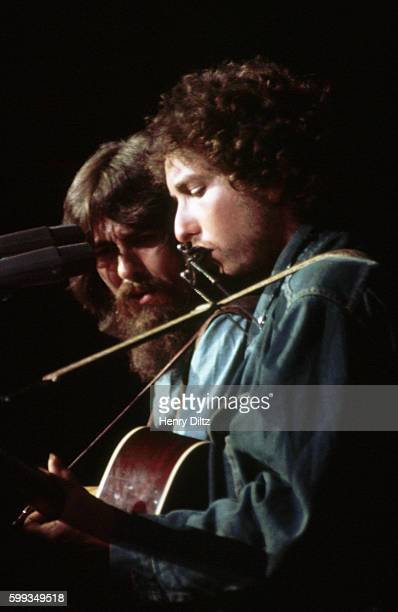 Bob Dylan and George Harrison perform together on stage at the Concert for Bangladesh George Harrison and Ravi Shankar organized the Concert for...