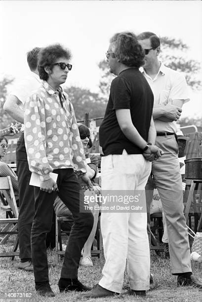 Bob Dylan and his manager Albert Grossman confer backstage at the Newport Folk Festival on July 25 1965 in Newport Rhode Island