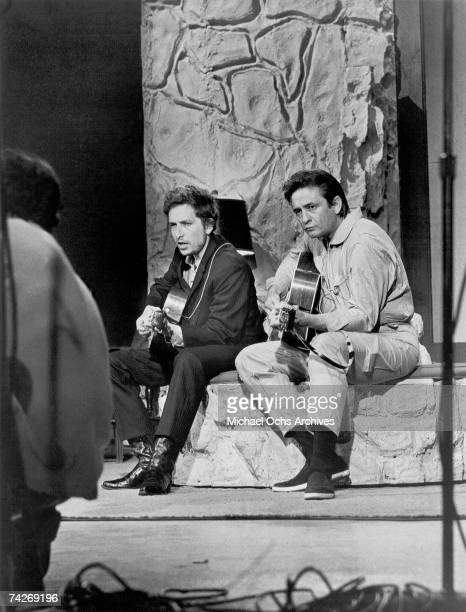 Bob Dylan and Johnny Cash perform together with acoustic guitars on 'The Johnny Cash Show' on June 7 1969 in Nashville Tennessee