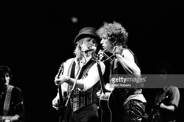 GARDEN Photo of Bob DYLAN and Tom PETTY and Tom PETTY The HEARTBREAKERS LR Tom Petty Bob Dylan performing live onstage with Tom Petty and The...