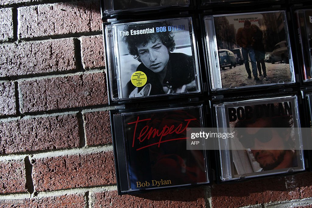 Bob Dylan CDs are displayed at the Bob Dylan Pop-Up Shop in New York City on September 10, 2012. The Pop-Up Shop is dedicated to his new album 'Tempest' which fans can purchase one day early along with other exclusive Bob Dylan merchandise. AFP Photo/Mehdi Taamallah