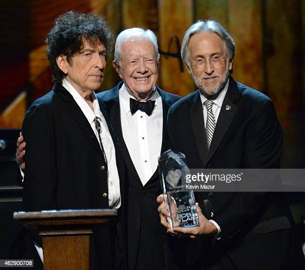 Bob Dylan Former United States President Jimmy Carter and National Academy of Recording Arts and Sciences President Neil Portnow speaks onstage at...