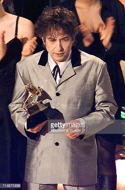 Bob Dylan holds his Grammy Award after winning in the Album of the Year Category at the 40th Grammy Awards at Radio City Music Hall in NEw York 25...