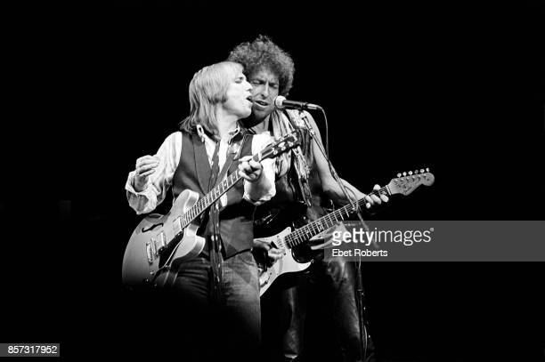 Bob Dylan performing with Tom Petty and The Heartbreakers at the Poplar Creek Music Theater in Chicago Illinois on June 29 1986