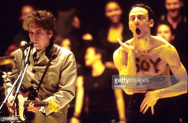 Bob Dylan performs 'Love Sick' alongside protester/performance artist 'Soy Bomb' 1998 Grammy Awards telecast during the The 40th Annual GRAMMY Awards...
