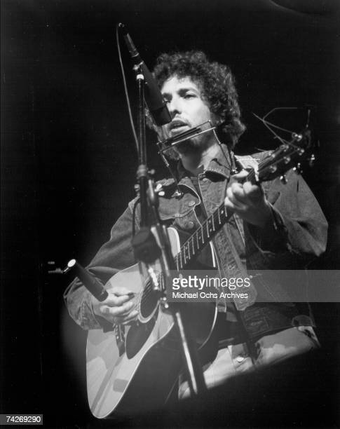 Bob Dylan performs on stage with a Martin acoustic guitar in circa 1976