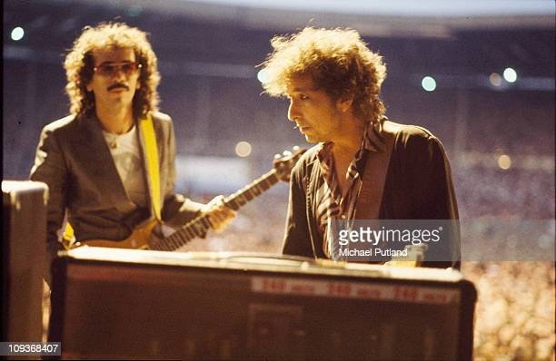 Bob Dylan performs on stage with Carlos Santana Wembley London 7th July 1984