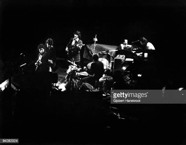 Bob Dylan performs on stage with the band Bob Dylan Robbie Robertson Rick Danko Levon Helm and Garth Hudson at Madison Square Garden on January 30th...